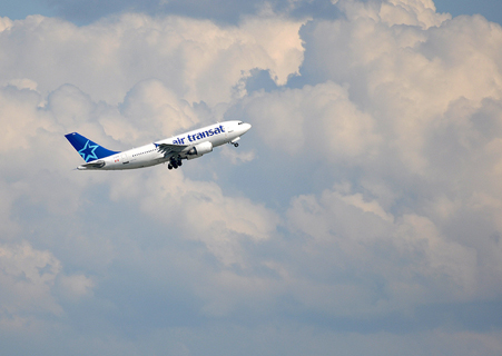 Cutting back on air travel is essential -- a single flight across the country wipes out the benefit of a person's environmental good deeds for an entire year. Photo: caribb/Flickr