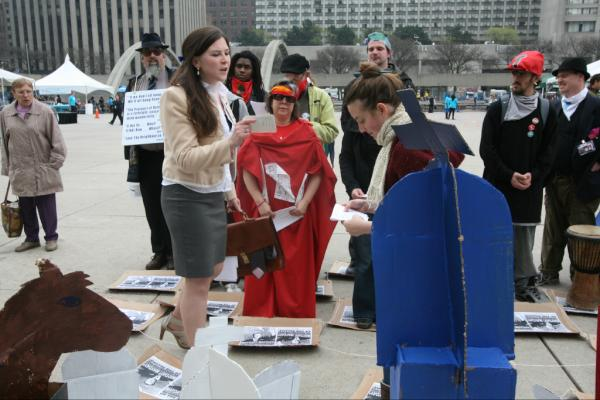 May Day actions in Toronto got started with some human chess at City Hall. (Photo: David Coombs)
