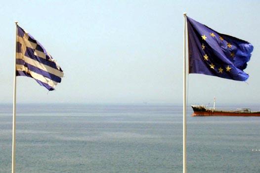 The Greek and European Union flags shredded. Photo: Iako