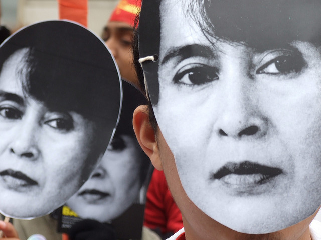 People wear Aung San Suu Kyi masks at a U.K. protest in 2007. Photo: lewishamdreamer/Flickr