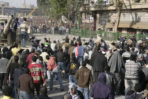 Anti and pro-Mubarak protesters clash at Tahrir square, in Cairo, Egypt, 2 Feb. 2011. The square was the scene of violent clashes between opposition protesters and pro-government supporters, with dozens reported injured. Photo: Nasser Nouri/Flickr