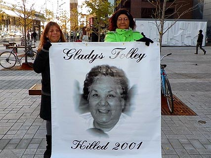 Bridget Tolley, right, with a poster of her mother, Gladys Tolley, who was struck and killed by a police car in Quebec in 2001. Photo: Bridget Tolley