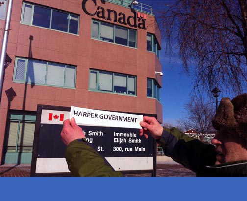 What you see is what you'll get: Whitehorse's David Skelton protests Harper's vision of the Yukon's Federal Building on Tuesday, March 8. Photo: Meagan Perry.