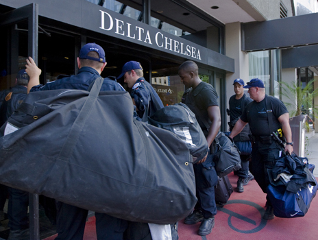 Five of the hundreds of police charged with G20 Summit security check in at Toronto's downtown Delta Chelsea Hotel. Meanwhile, The People's Summit takes place this weekend. Photo: Kristen Hanson
