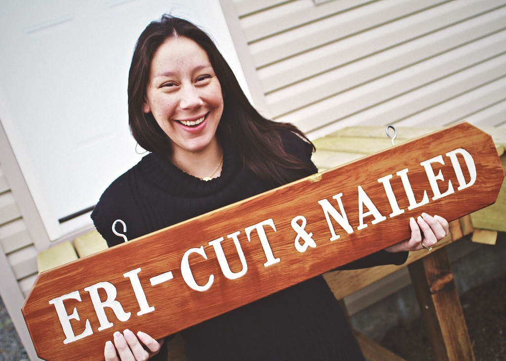 Erica Ryan-Gagne displays Eri-Cut & Nailed signage outside of her new salon loca